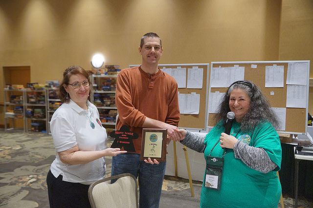 First place winner Chris Bert receives his plaque from GM Michelle Hymowitz