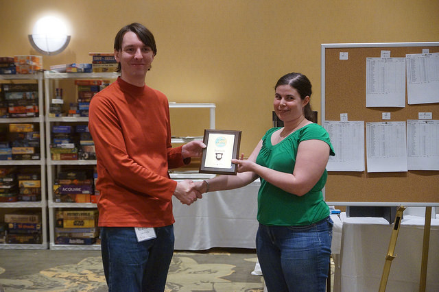 Laura DeWalt receives the first place plaque from GM Andrew Emerick