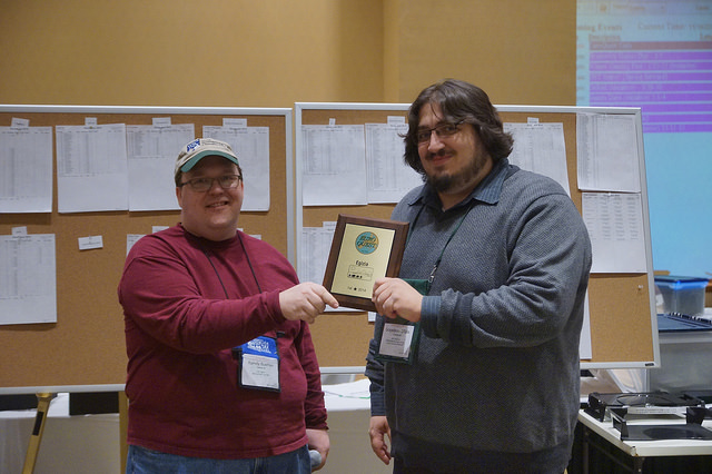 GM Randy Buehler presents Sceadeau with his first place plaque