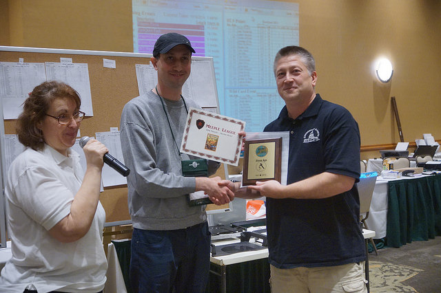 Aran Warszawski is awarded second place by GM Scott Saccenti